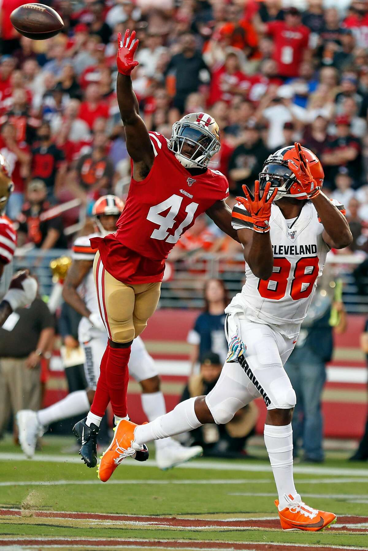 San Francisco 49ers' Emmanuel Moseley breaks up a pass intended for Cleveland Browns' Demetrius Harris in 2nd quarter during NFL game at Levi's Stadium in Santa Clara, Calif., on Monday, October 7, 2019.