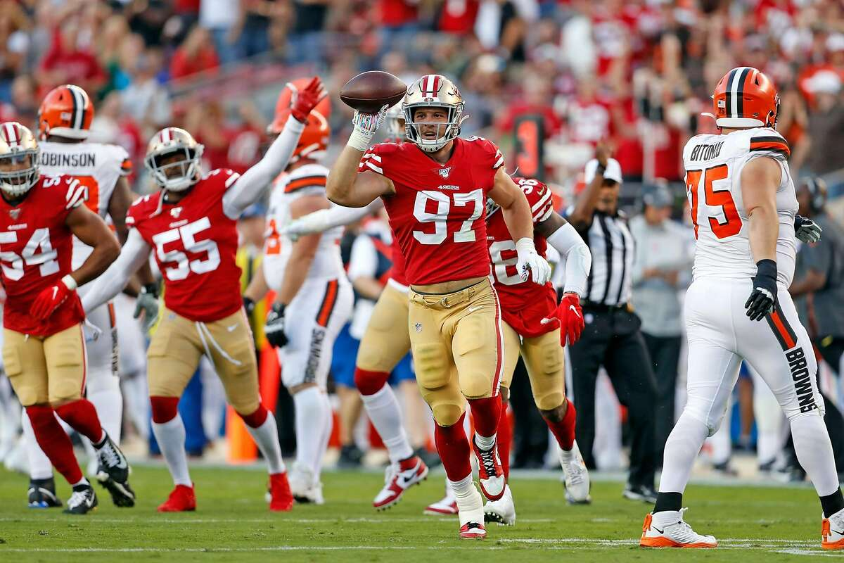 San Francisco 49ers' Nick Bosa celebrates his recovery of a fumble by Cleveland Browns' Baker Mayfield in 1st quarter during NFL game at Levi's Stadium in Santa Clara, Calif., on Monday, October 7, 2019.