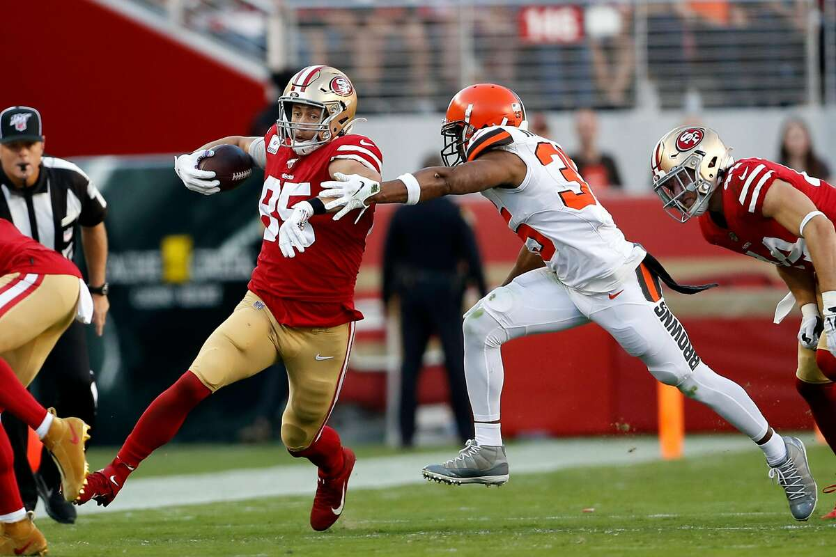 San Francisco 49ers' George Kittle runs after a catch against Cleveland Browns' Jermaine Whitehead in 1st quarter during NFL game at Levi's Stadium in Santa Clara, Calif., on Monday, October 7, 2019.