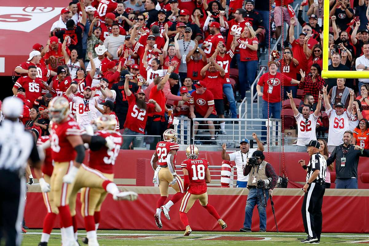San Francisco 49ers' Matt Breida and Dante Pettis celebrate Breida's 83-yard touchdown run in 1st quarter against Cleveland Browns during NFL game at Levi's Stadium in Santa Clara, Calif., on Monday, October 7, 2019.