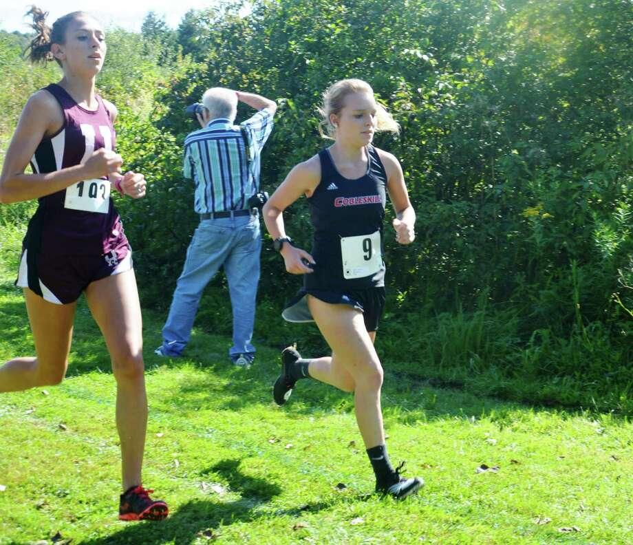 Cobleskill-Richmondville High School graduate Ashley Kubat, right, of the Cobleskill cross country team. (Courtesy of Cobleskill Athletics)