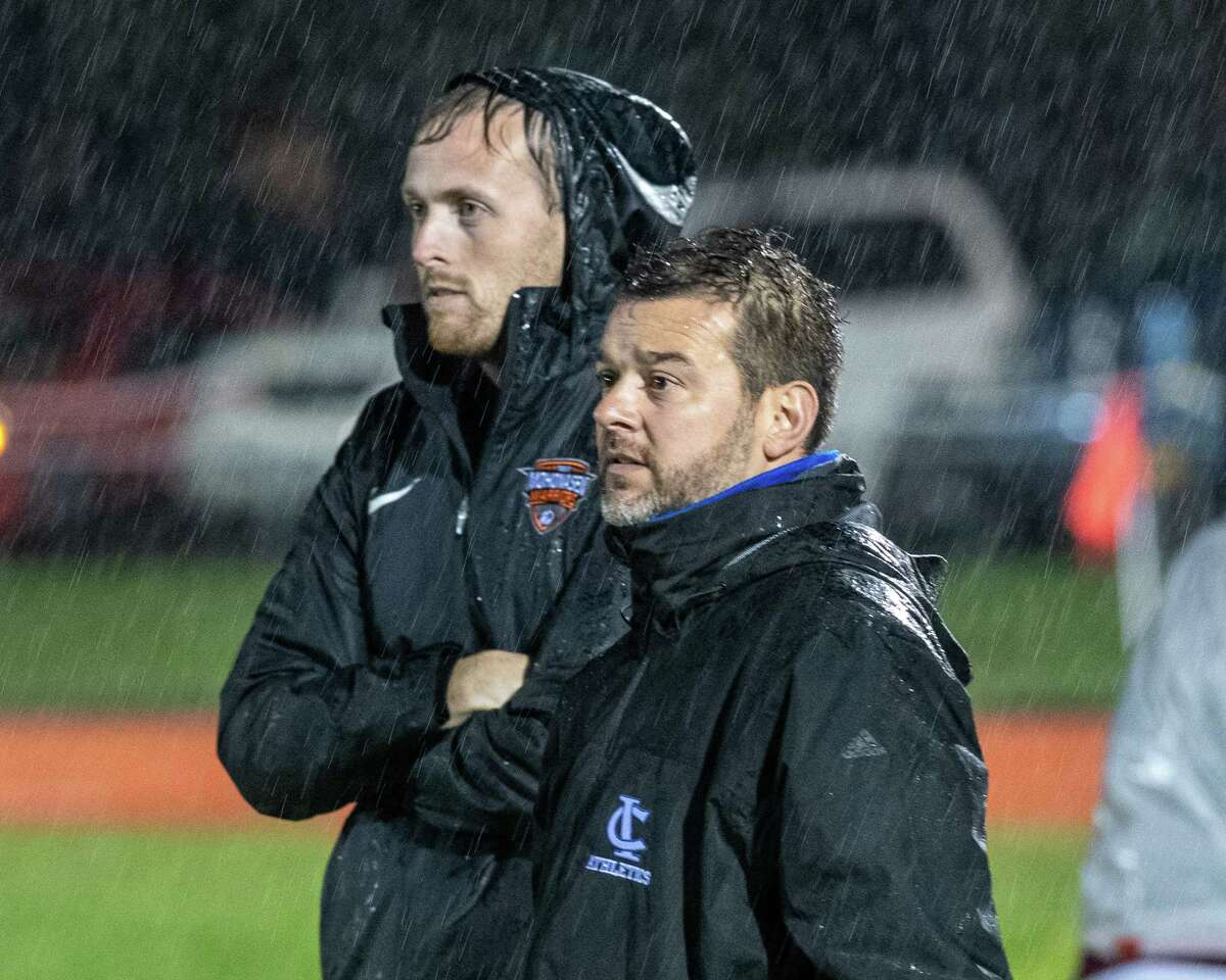 Mohonasen High School soccer coach Robert Stranahan (left) and Ichabod Crane coach Mike Young watch their teams play a Colonial Council matchup at Ichabod Crane High School on Monday, Oct. 7, 2019 (Jim Franco/Special to the Times Union.)