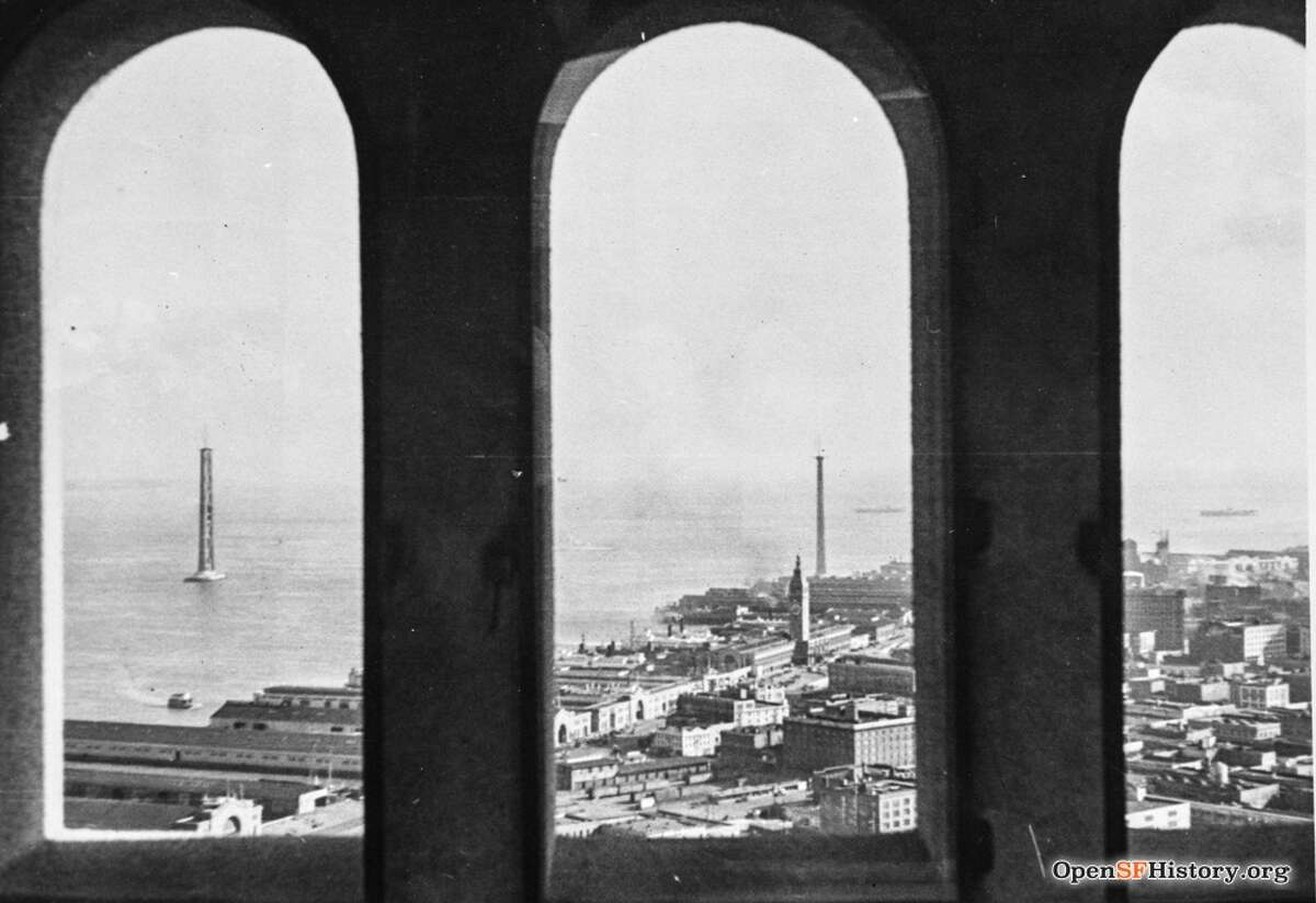 The view from the observation deck inside Coit Tower on Telegraph Hill in 1935. In the distance, you can see the rising towers of the Bay Bridge.