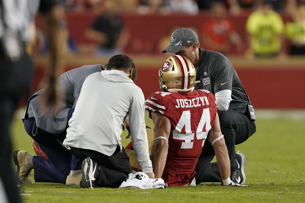 San Francisco 49ers fullback Kyle Juszczyk (44) is tended to by trainers during the second half of an NFL football game against the Cleveland Browns in Santa Clara, Calif., Monday, Oct. 7, 2019. (AP Photo/Tony Avelar)