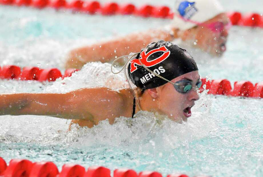 New Canaan's Alex Mehos competes in the butterfly during a swim meet at Greenwich High School on Oct. 4, 2019. Photo: Matthew Brown / Hearst Connecticut Media / Stamford Advocate