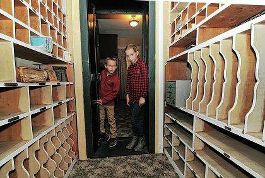 Bennett Leslie, 8, and his sister, Arianne, 12, both of Jerseyville, peer into the Cheney Mansion vault while taking a tour of the historic home. The Jersey County Historical Society offered tours of the mansion and other historic buildings this weekend during the nonprofit organization's annual Apple Festival. Photo: David Blanchette   For Hearst Illinois