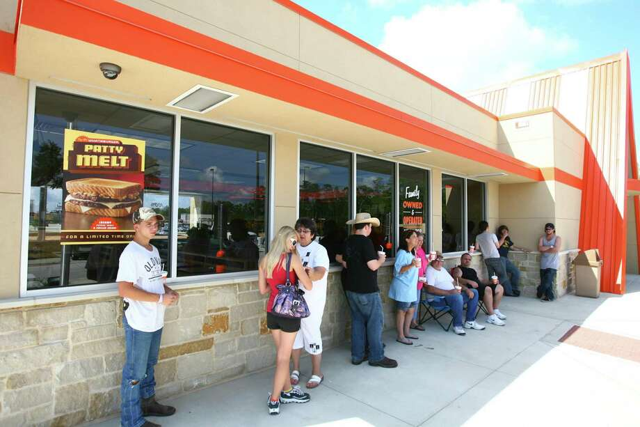 Whataburger customers, some of whom have camped out since Sunday night, wait in line to be one of the first 20 customers to receive free food for a year at the grand opening of a Whataburger restaurant in Willis. Photo: Staff Photo By Karl Anderson / Staff photo by Karl Anderson