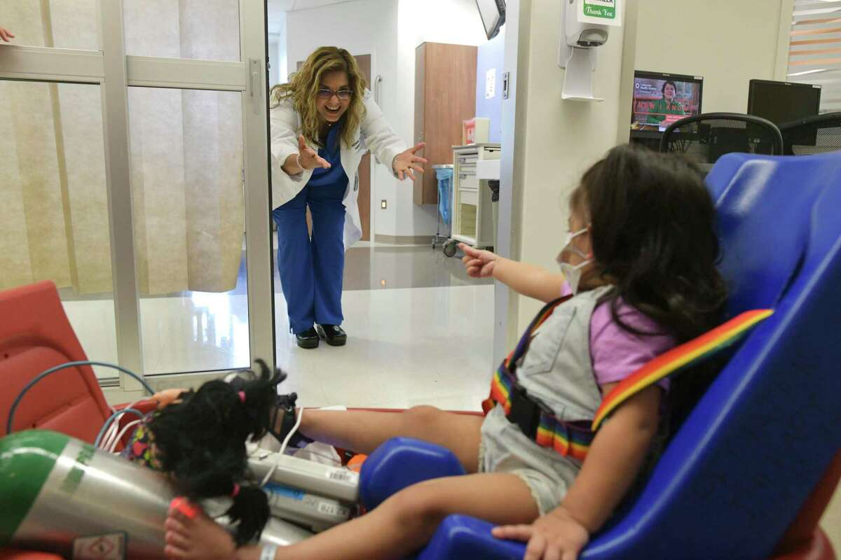 Dr. Veronica Armijo-Garcia calls to Addison. The toddler spent 27 days on an ECMO machine, which allowed her heart and lungs to rest while her body healed.