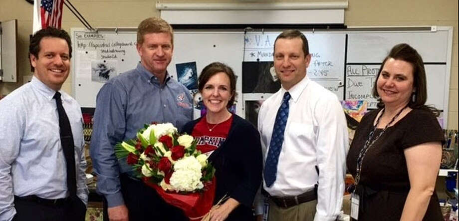 Christie Skinner, Fine Arts Department chair at Obra D. Tompkins High School, was honored in2015-16 as Tompkins Teacher of the Year. From left are:Andrew Rizzo, assistant principal; Mark Grisdale, principal; Skinner; Ryan Labay, associate principal; and Kristine Copeland, student support assistant principal. Photo: Courtesy Katy Independent School District