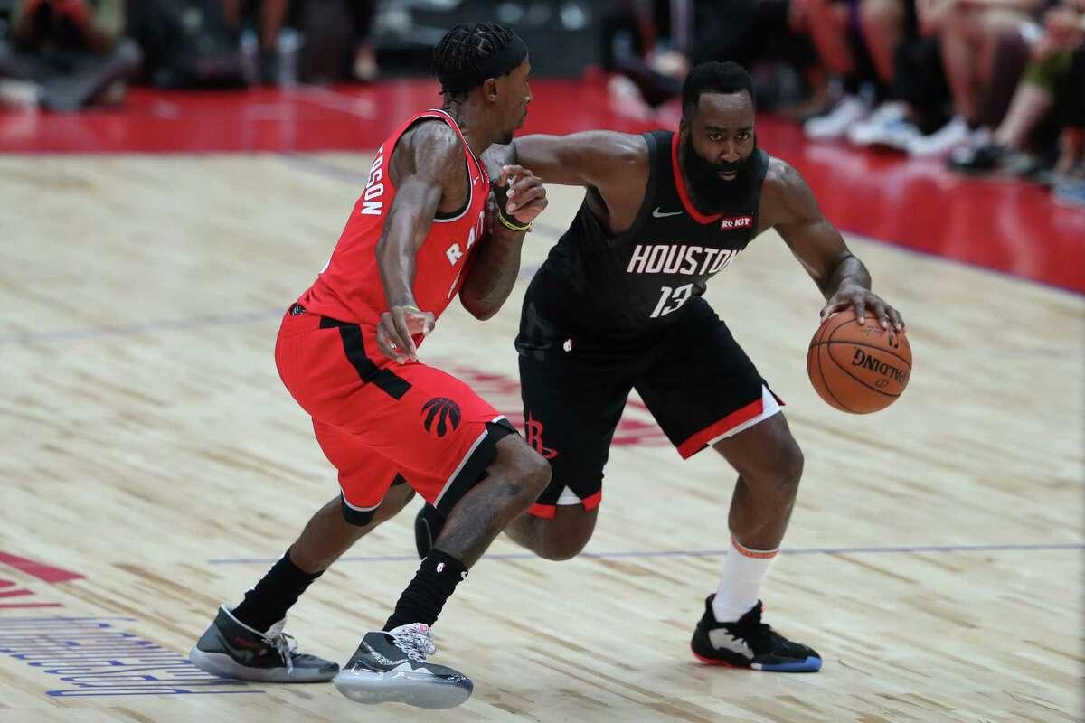 SAITAMA, JAPAN - OCTOBER 08: James Harden #13 of Houston Rockets handles the ball against Rondae Hollis-Jefferson #4 of Toronto Raptors during the preseason game between Houston Rockets and Toronto Raptors at Saitama Super Arena on October 08, 2019 in Saitama, Japan.