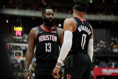 Houston Rockets' James Harden, left, talks to Russell Westbrook during the first half of an NBA preseason basketball game against the Toronto Raptors Tuesday, Oct. 8, 2019, in Saitama, near Tokyo. (AP Photo/Jae C. Hong)