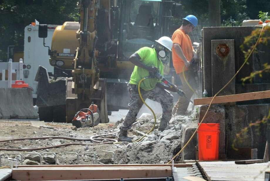 Construction crews work on the West Rocks Road bridge over the Merritt Parkway in Norwalk. Photo: Alex Von Kleydorff / Hearst Connecticut Media / Norwalk Hour