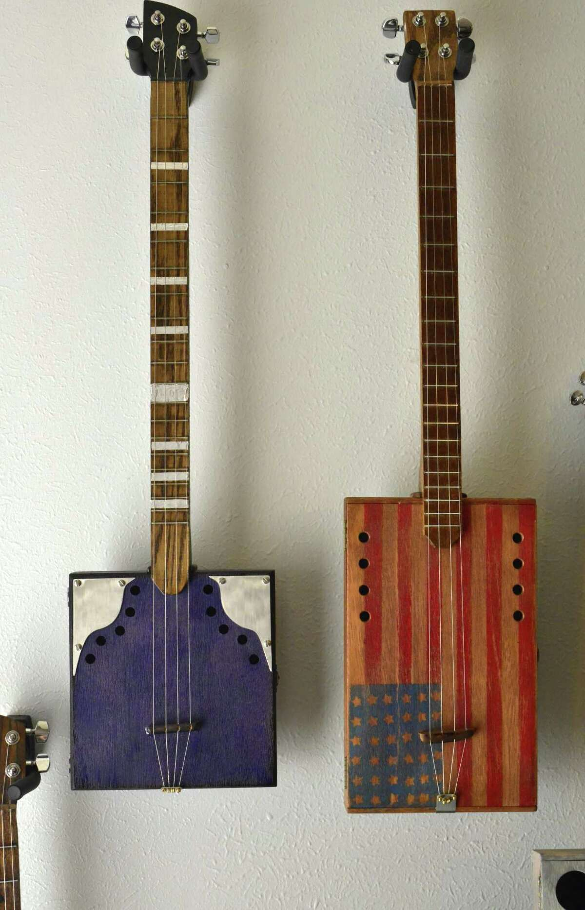 In this age of repurposing, Dave Mullican of Fannett has found a unique way to reuse cigar boxes: he makes them into guitars and ukuleles.
