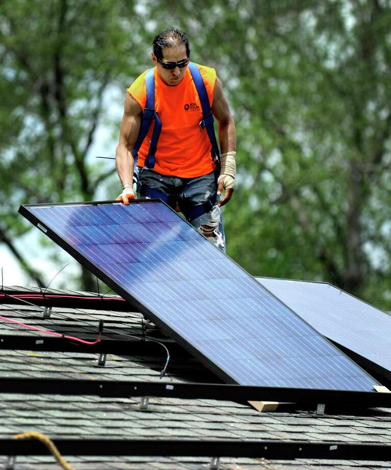A Ross Solar Group technician on a job in May 2015 in Brookfield, Conn. Photo: Carol Kaliff / Carol Kaliff / The News-Times