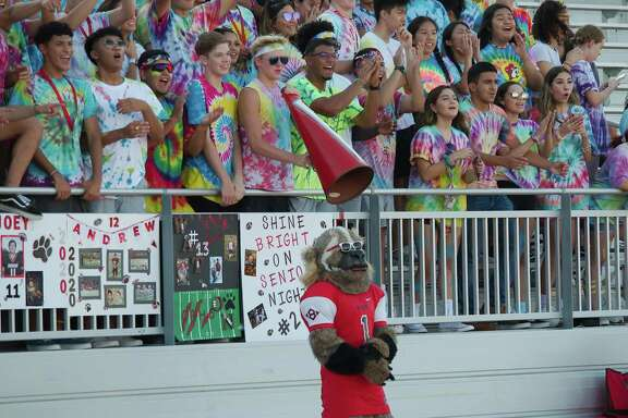 The Clear Brook Wolverine mascot along with Clear Brook fans show support earlier this season against Friendswood.