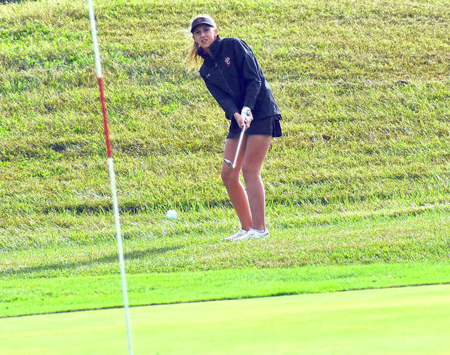 Edwardsville sophomore Grace Daech watches her shot land on the green during the Gary Bair Tournament at Oak Brook Golf Club.