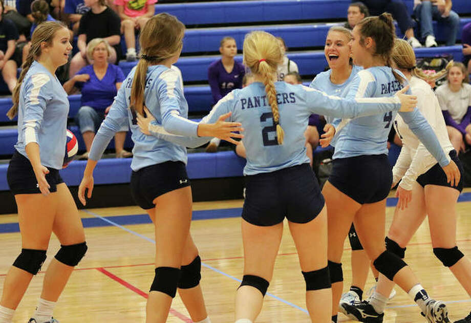 The Jersey Panthers celebrate a point during against Marquette on Aug. 27 at the Roxana Tourney. The Panthers were at home Monday night and improved their record to 15-8 with a three-set victory over Greenfield in Jerseyville. Photo: Greg Shashack / The Telegraph