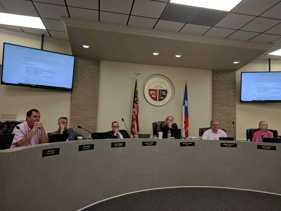 City Council Members discuss updating the city's impact fees and other issues during their Oct. 7 council meeting. Photo: Paul Wedding