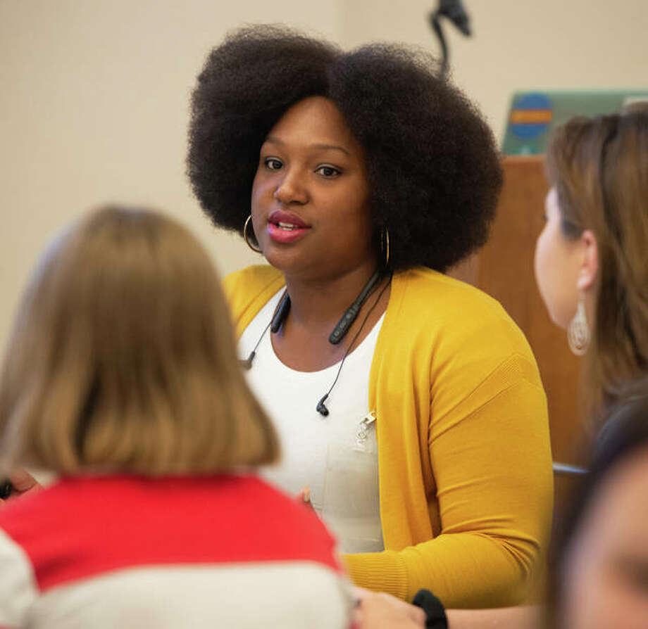 SIUE senior Ronada Hood speaks with high school students during a Human Library Summit Oct. 4.