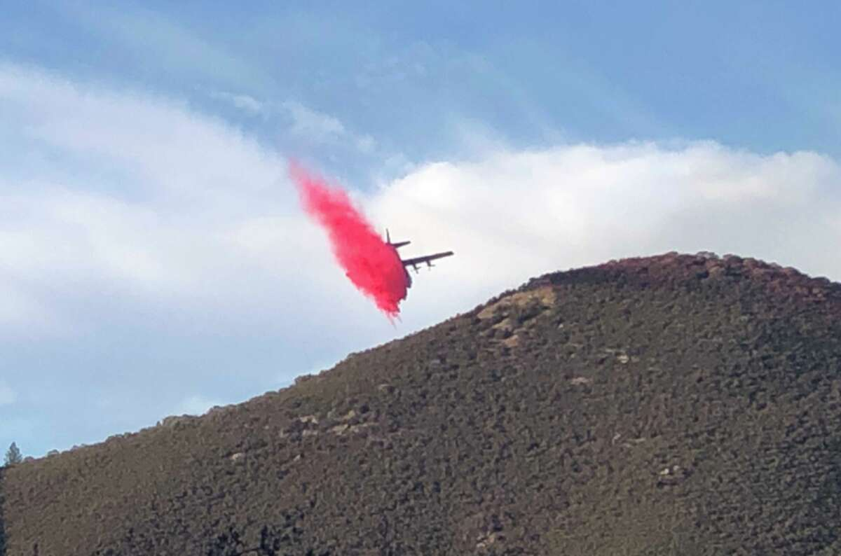 A plane drops slurry on the Briceburg Fire near the Mariposa County town of Briceburg. (Oct. 7, 2019.)