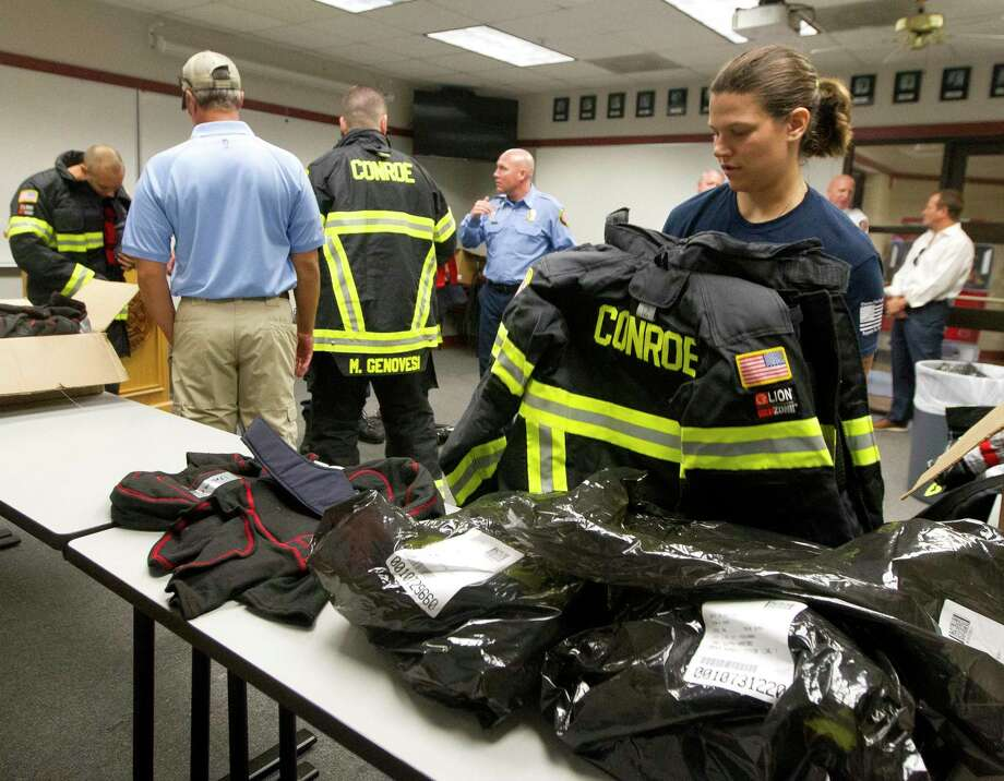 Conroe firefighter Sarah Harford tries on new bunker gear at Conroe Fire Station 1, Monday, Oct. 7, 2019, in Conroe. The gear was part of more than 120 sets issued to firefighters totallying $415,000 the Conroe City Councile approved in March as part of a larger $700,000 investment toward the city's firefighter cancer prevention program. Photo: Jason Fochtman, Houston Chronicle / Staff Photographer / Houston Chronicle