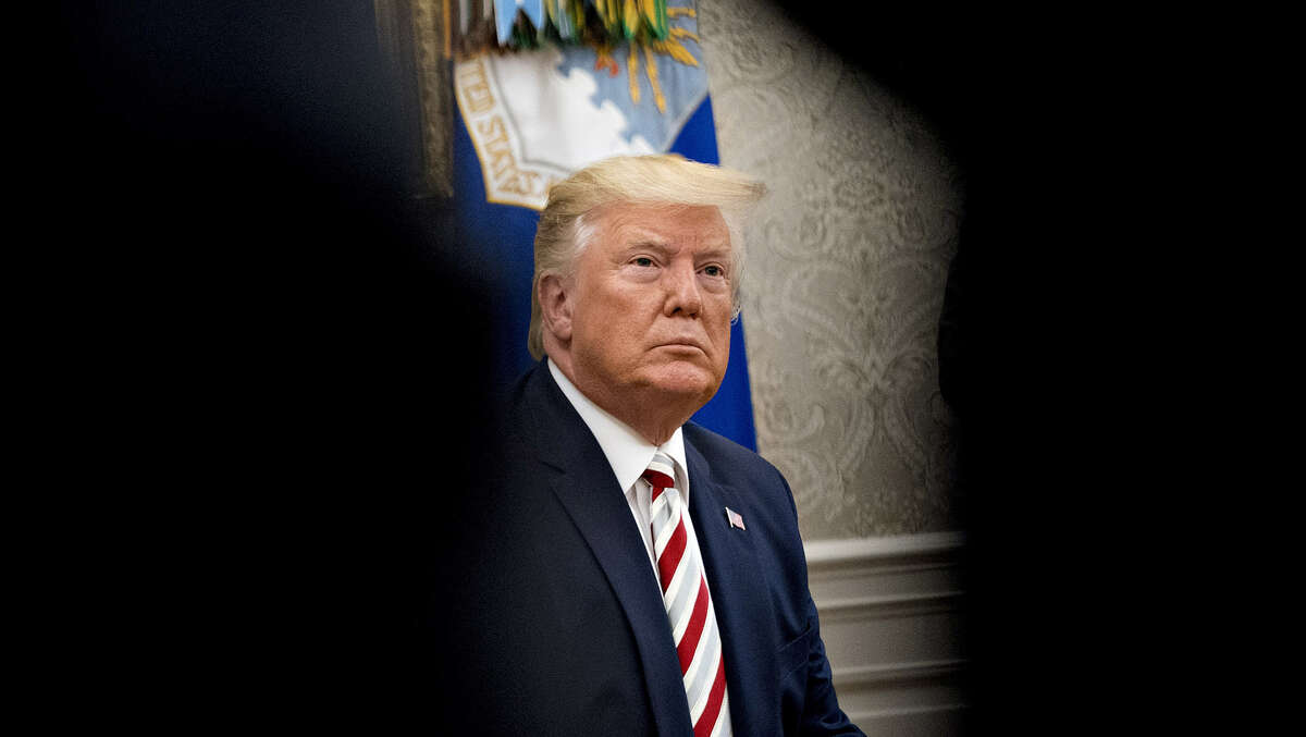 President Donald Trump listens to a question in the Oval Office of the White House in Washington on Aug. 20, 2019.