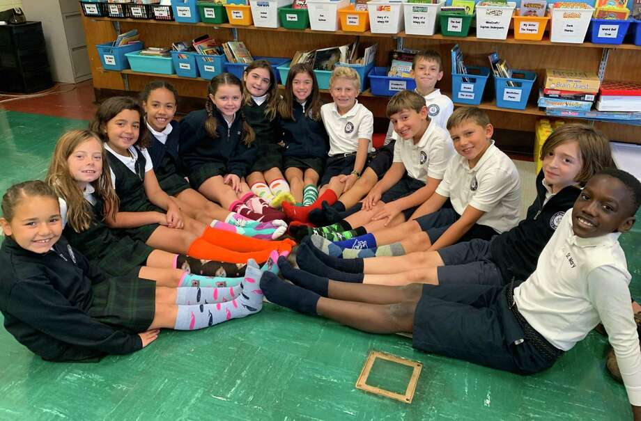 St. Mary School students wore crazy socks and raised $932 to help the people of the Bahamas recover after Hurricane Dorian. In addition, a St. Mary family matched the amount with a check for $1,864, being sent to go towards relief efforts. Photo: Contributed Photo.