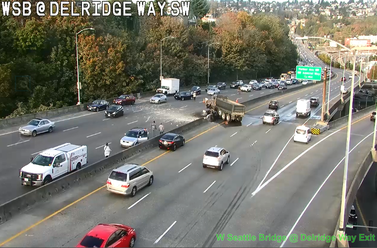 1 dead, 1 injured after head-on collision involving SUV, semi truck in Seattle's Sodo district