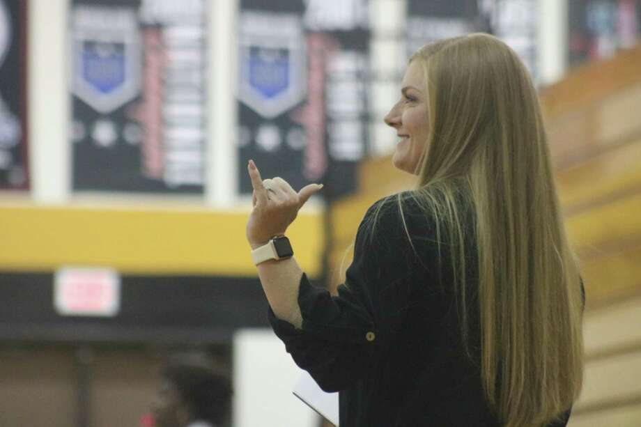 Memorial High School head coach Kasie Fernandez flashes the Mavs sign during last Friday's Pasadena match, something the team does whenever they're at game point to a set. The team plays at Humble tonight. Photo: Robert Avery