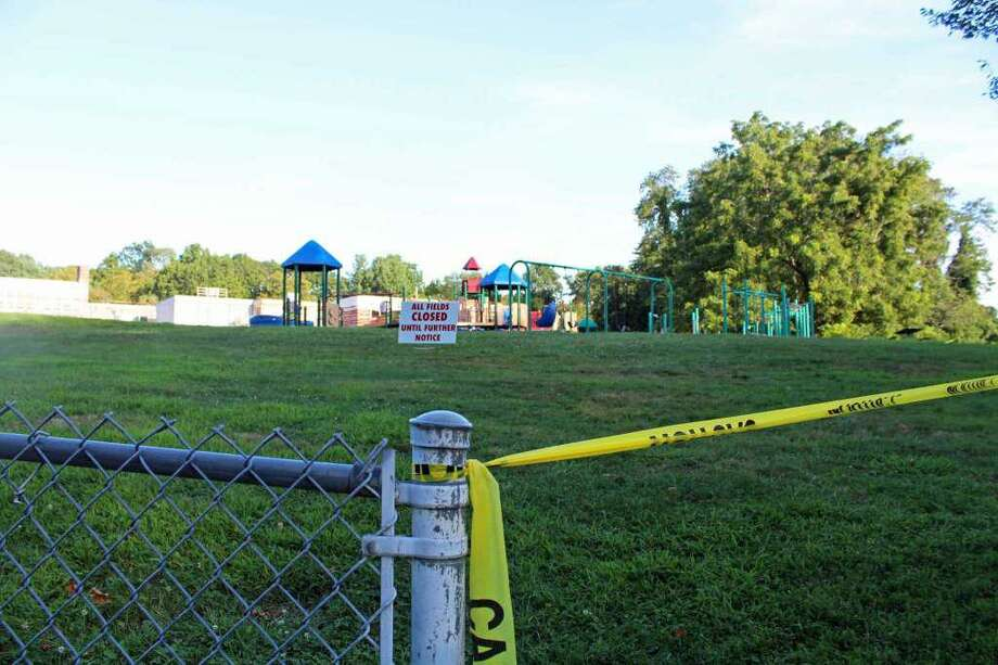The walkway to the playground at Mill Hill Elementary School is one of eight sites closed for remediation. Photo: Rachel Scharf / Hearst Connecticut Media