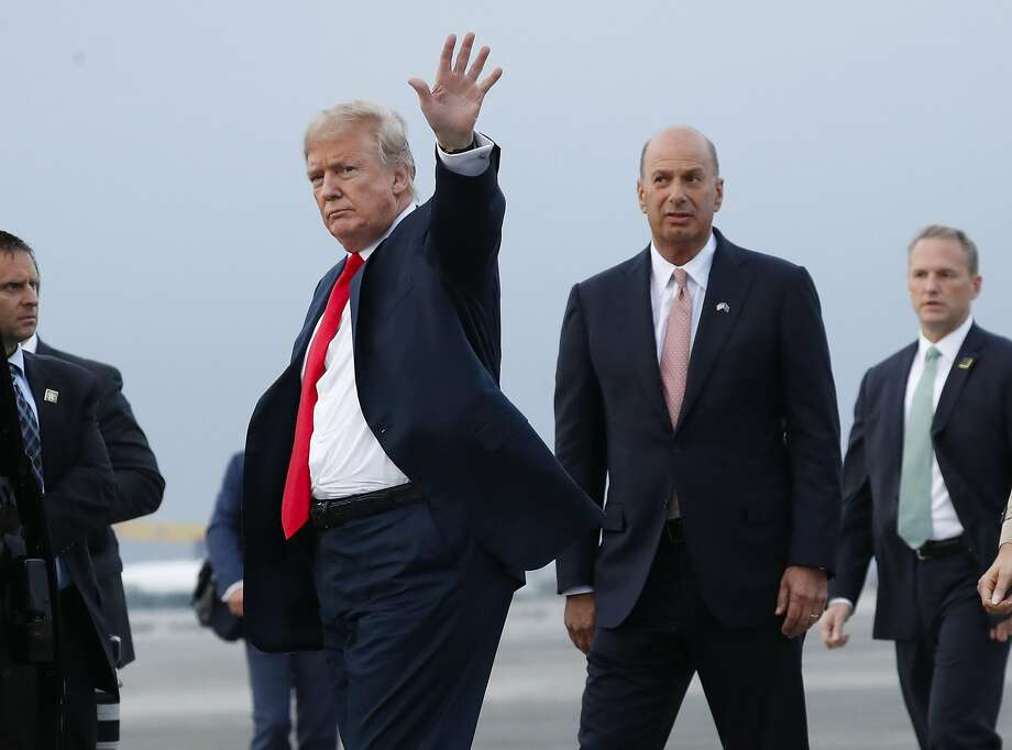 FILE - In this Tuesday, July 10, 2018, file photo, President Donald Trump is joined by Gordon Sondland, the U.S. ambassador to the European Union, second from right, as he arrives at Melsbroek Air Base, in Brussels, Belgium. According to text messages released the first week of October 2019 by House investigators, Ambassador Gordon Sondland and Kurt Volker, a former special envoy to Ukraine, discussed Trump wanting to press Ukrainian President Volodymyr Zelenskiy to investigate Trump's Democratic political rival Joe Biden and his family. The House Intelligence Committee is scheduled to meet in private with Sondland. (AP Photo/Pablo Martinez Monsivais, File) Photo: Pablo Martinez Monsivais, Associated Press