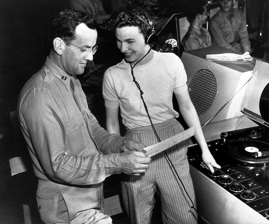 "Marjorie Ochs, the only female in the radio program ""Sustain the Wings,"" goes over the script with bandleader Capt. Glenn Miller on June 16, 1943, at Yale University. The show was presented by the Army Air Force's Technical Training Command at Yale over a national radio hook-up. Photo: Bettman Archive / Getty Images / Bettmann"