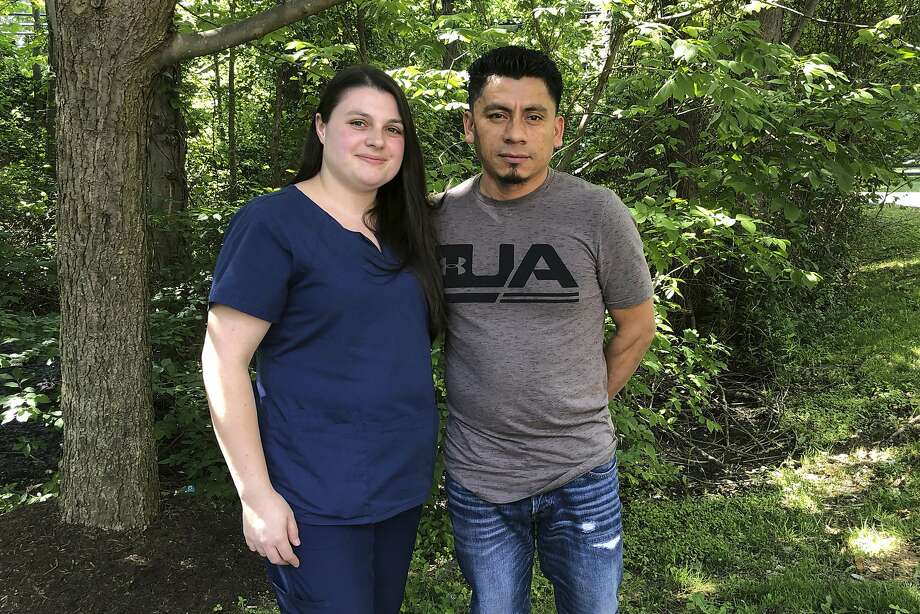 In a photo taken June 21, 2019, Alyse Sanchez and her husband, Elmer Sanchez, pose for The Associated Press in Sandy Spring, Md. The Sanchezes and five other couples have filed a lawsuit in U.S. District Court in Maryland arguing U.S. immigration authorities are luring couples to marriage interviews only to detain the immigrant spouses. (AP Photo/Regina Garcia Cano) Photo: Regina Garcia Cano / Associated Press