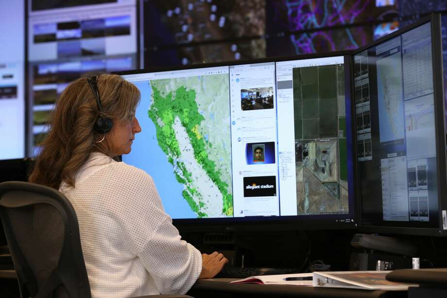 PG&E Senior Wildfire Operations Center Analyst Sarah Gibson monitors weather and satellite images of fire areas at the PG&E Wildfire Safety Operations Center on August 05, 2019 in San Francisco. PG&E opened up its Wildfire Safety Operations Center earlier this year to monitor potential wildfire threats throughout its service area. The office will be staffed 24 hours a to help coordinate with public safety officials and first responders when wildfires start. Photo: Justin Sullivan/Getty Images