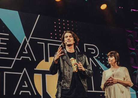 """FILE -- Adam Neumann, WeWork's chief executive, alongside his sister, Adi, onstage at the """"2018 Creator Awards at Madison Square Garden in New York, Jan. 17, 2018."""