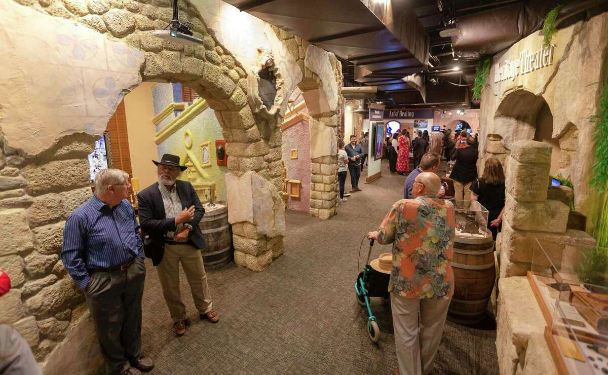 Visitors tour Tuesday, Oct. 8, 2019 the just-opened Bexar County Heritage Center in the Bexar County Courthouse. The facility features a series of exhibits that take visitors through the county's history.