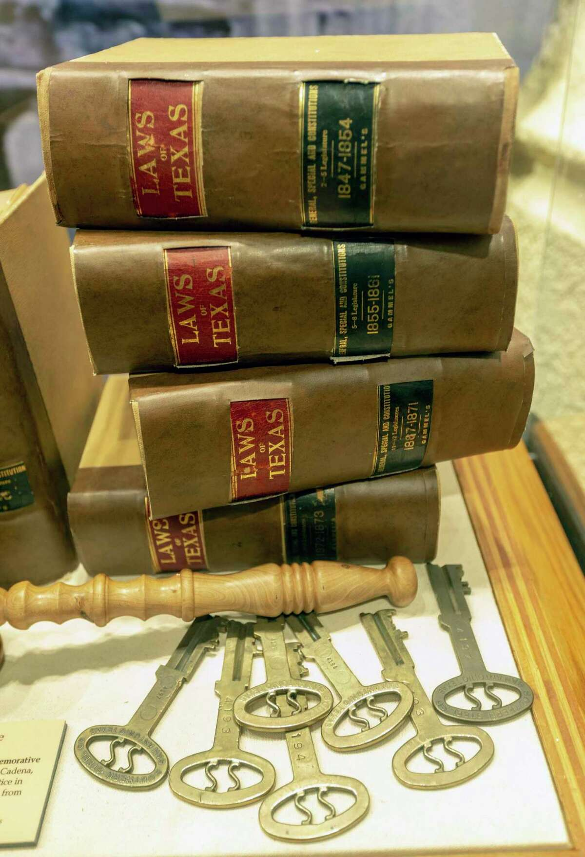 An exhibit seen Oct. 8, 2019 at the newly opened Bexar County Heritage Center in the Bexar County Courthouse exhibits old lawbooks and antique jail cell keys. The museum-like center features a series of exhibits that take visitors through the county's history.