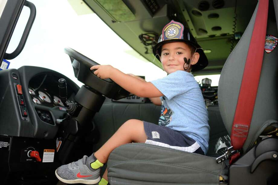 Tyler Parks, 3, sits in a fire truck during the National Day Out Event at the Fort Bend County Precinct 3 Annex in Katy on Saturday, Sept. 28. Photo: Craig Moseley, Houston Chronicle / Staff Photographer / ©2019 Houston Chronicle