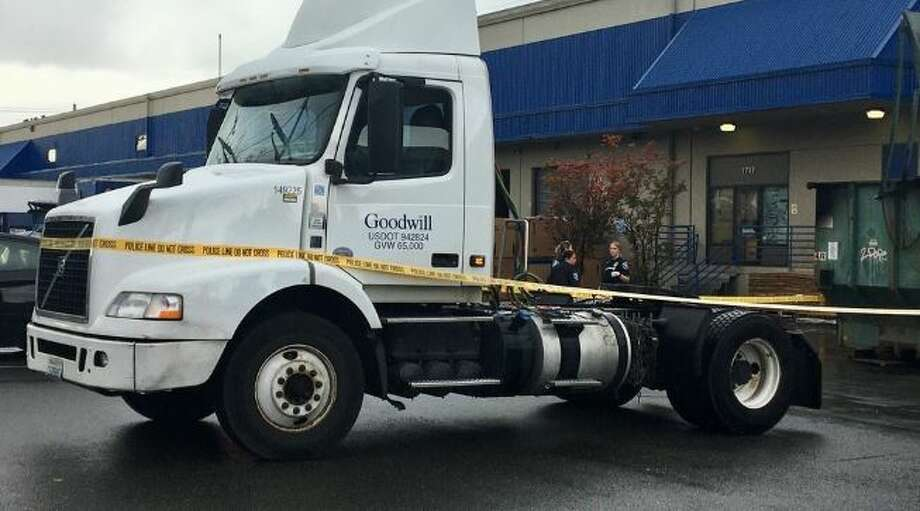 Police investigate after a man was crushed between a semi and a wall at Seattle Goodwill. Photo: Courtesy KOMO News