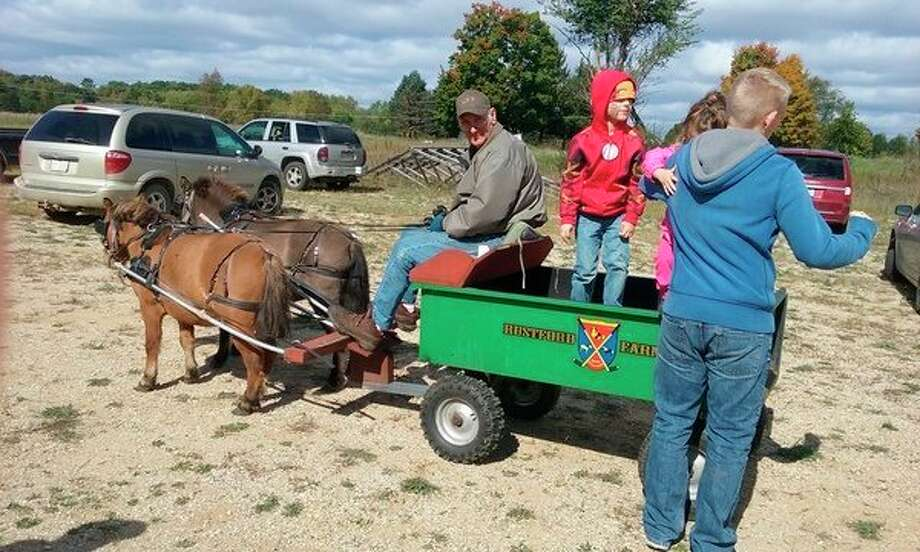 Weather permitting, kids will be able to enjoy miniature horse rides.Rain or shine, they will be able to participate in a variety of crafts and games as well. (Pioneer file photo)