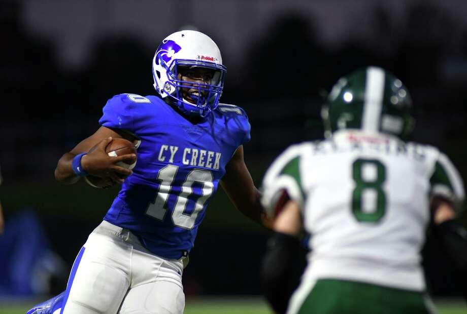 Cy Creek senior quarterback Julian Uwadia (10) looks for a running lane earlier this season. Photo: Jerry Baker, Houston Chronicle / Contributor / Houston Chronicle