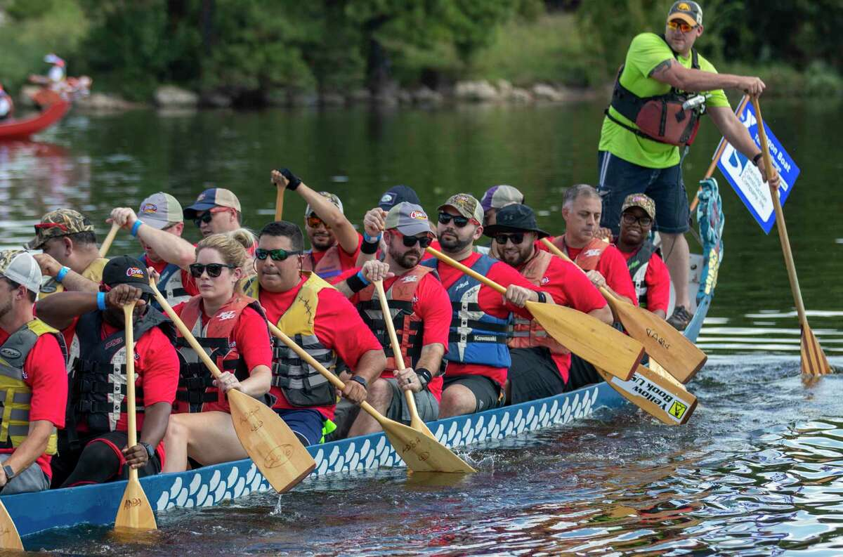 Members of the Raising Cane's team paddle out to start their race during the 21st annual Dragon Boat Races on Thursday, September 26, 2019 at Northshore Park in The Woodlands.