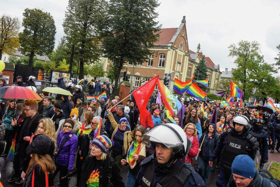 People hold rainbow flags during an Equality/Pride march on October 06, 2019 in Nowy Sacz, Poland. The first march of its kind to take place in Nowy Sacz was originally banned by the mayor, but the decision was quashed by a local court allowing it to take place. A counter march has been organised by the local church, the March for Life and Family, to promote conservative catholic values. Polands ruling Law and Justice (PiS) party has used LGBT rights as a key campaign issue claiming it as a threat to the Polish Catholic values. (Photo by Omar Marques/Getty Images) Photo: Omar Marques / Getty Images / 2019 Getty Images