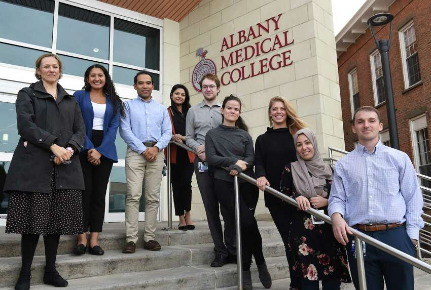 From left, supervisor Dr. Victoria Balkoski, chair of department of psychiatry, Kristiana Hanna, Makai Dunne, Divya Dasani, Brian Caldwell, Jasmine Landry, Anna Blaeser, Sarah Saad and Bill Calawerts stand outside Albany Medical College on Tuesday, Oct. 8, 2019 in Albany, N.Y. Not pictured are Magha Dasani, Sharmeen Azher, Megan Gupta and Ernesto Acosta. The group of Albany doctors and med students have been providing asylum seekers with medical and psychiatric evaluations for court to help them gain status. (Lori Van Buren/Times Union)