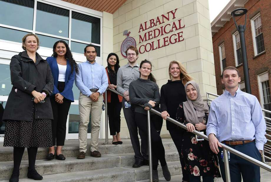 From left, supervisor Dr. Victoria Balkoski, chair of department of psychiatry, Kristiana Hanna, Makai Dunne, Divya Dasani, Brian Caldwell, Jasmine Landry, Anna Blaeser, Sarah Saad and Bill Calawerts stand outside Albany Medical College on Tuesday, Oct. 8, 2019 in Albany, N.Y. Not pictured are Magha Dasani, Sharmeen Azher, Megan Gupta and Ernesto Acosta. The group of Albany doctors and med students have been providing asylum seekers with medical and psychiatric evaluations for court to help them gain status. (Lori Van Buren/Times Union) Photo: Lori Van Buren, Albany Times Union / 40047954A