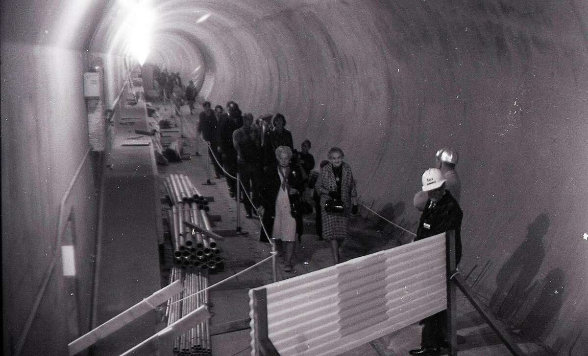 Thousands line up to walk in the recently completed BART tube, November 9, 1969