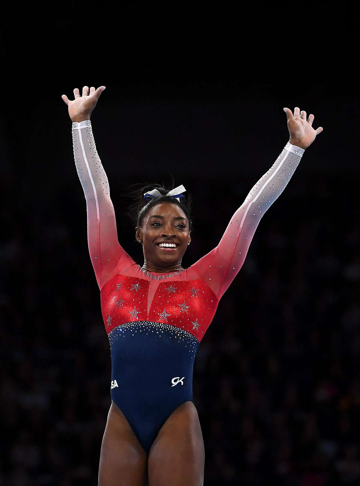 STUTTGART, GERMANY - OCTOBER 08: Simone Biles of USA waves to the crowd after finishing her floor routine during the Women's Team Finals on Day 5 of FIG Artistic Gymnastics World Championships on October 08, 2019 in Stuttgart, Germany. (Photo by Laurence Griffiths/Getty Images)