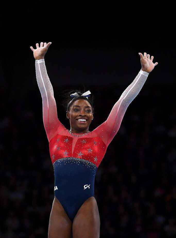 STUTTGART, GERMANY - OCTOBER 08: Simone Biles of USA waves to the crowd after finishing her floor routine during the Women's Team Finals on Day 5 of FIG Artistic Gymnastics World Championships on October 08, 2019 in Stuttgart, Germany. (Photo by Laurence Griffiths/Getty Images) Photo: Laurence Griffiths, Getty Images