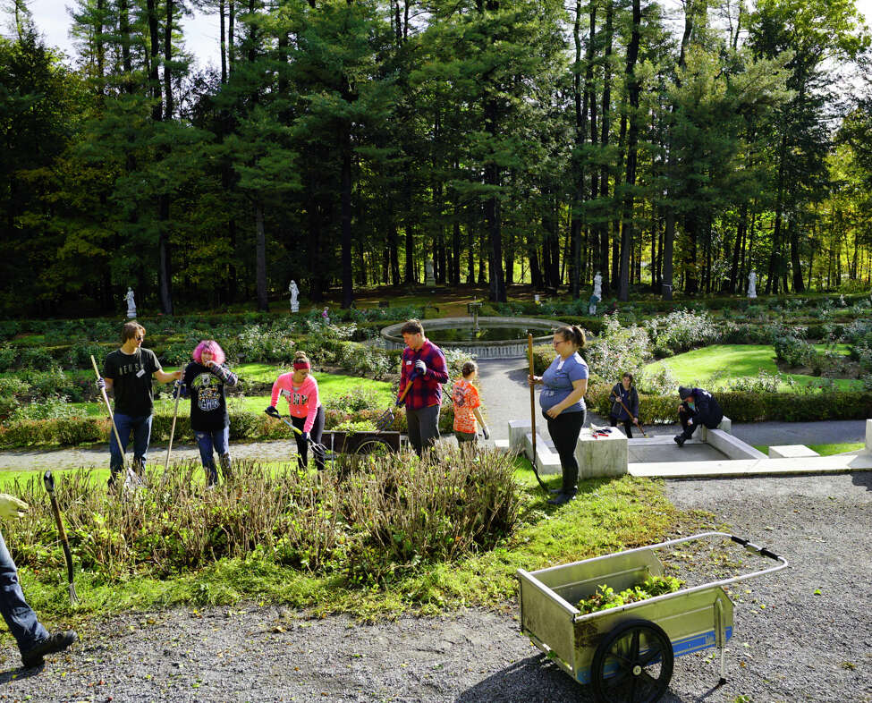 BOCES horticulture students work at Yaddo gardens on Tuesday, Oct. 8, 2019, in Saratoga Springs, N.Y. Volunteers and BOCES horticulture students worked in the gardens on Tuesday preparing the grounds for the winter. BOCES students have been working with volunteers at the gardens for the past 20 years. (Paul Buckowski/Times Union)