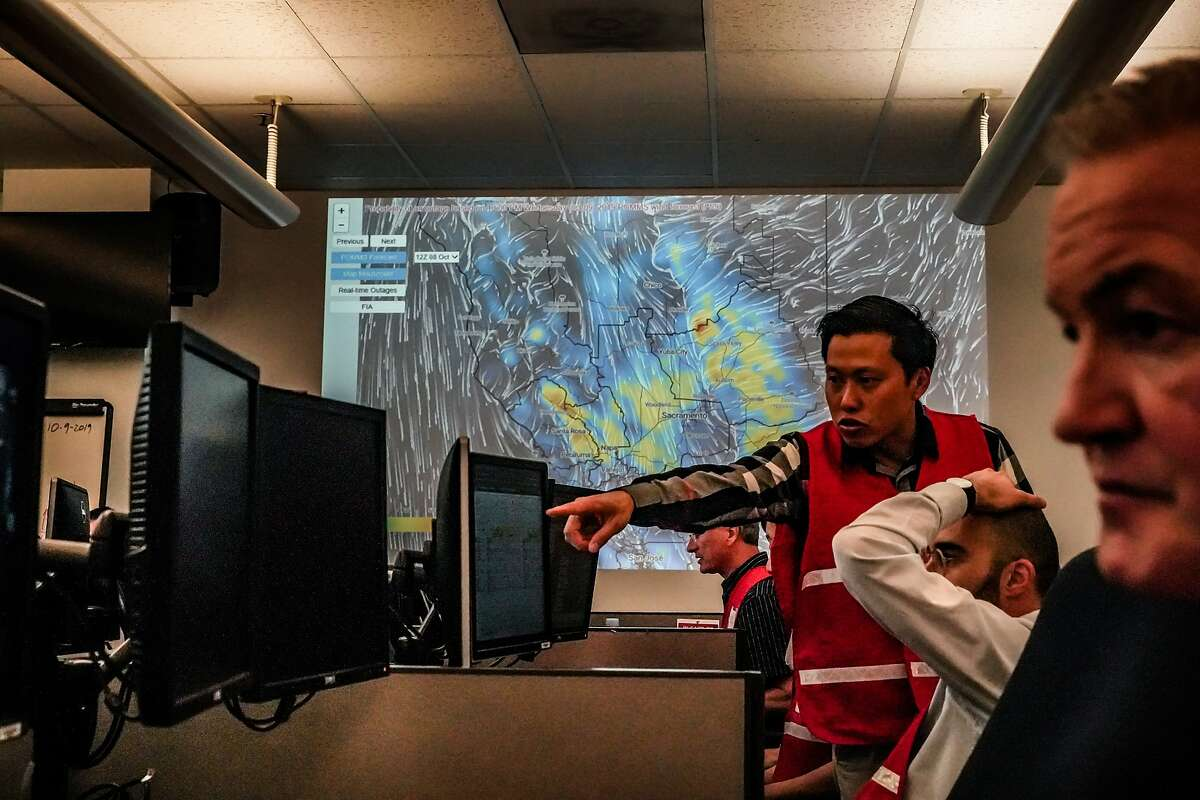 PG&E employees working at the emergency operations center where public safety shutoff was confirmed for nearly 800,000 customers in Calif. on Tuesday, Oct. 8, 2019 in San Francisco, Calif.